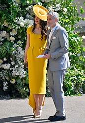 Amal Clooney and George Clooney arrive at St George's Chapel at Windsor Castle for the wedding of Megan Markle and Prince Harry.