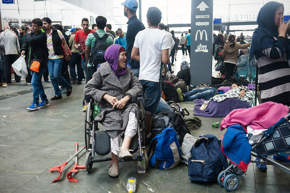 Morning, Tuesday 15th of September 2015. Vienna central station. Hundreds of refugees and migrants are waiting at the central hall of the station. This woman in her nineties traveled all the way from Afghanistan with her family.