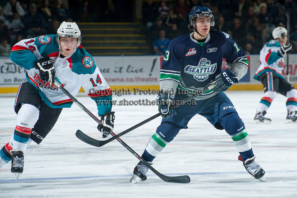 KELOWNA, CANADA -FEBRUARY 10: Rourke Chartier #14 of the Kelowna Rockets checks Mathew Barzal #13 of the Seattle Thunderbirds on February 10, 2014 at Prospera Place in Kelowna, British Columbia, Canada.   (Photo by Marissa Baecker/Getty Images)  *** Local Caption *** Rourke Chartier; Mathew Barzal;