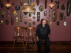 Greg Martin asked me to take a portrait of his family in the family home, we were greeted by his collection of tribal masks that he and his wife collected in their travels. In some ways this portrait is a type of family portrait as well, not one of blood ties, but of stories.