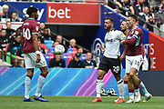 Aston Villa midfielder Jack Grealish (10) holds back Derby County striker Mason Bennett (20) after a tackle from Aston Villa defender (on loan from AFC Bournemouth) Tyrone Mings (40) during the EFL Sky Bet Championship play off final match between Aston Villa and Derby County at Wembley Stadium, London, England on 27 May 2019.