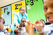 Atlanta Public Schools Superintendent Dr. Beverly Hall interacts with kindergarteners while they sort living and unliving items in a science lab at Centennial Place Elementary School in Atlanta August 4, 2010.