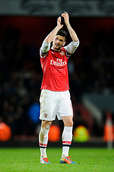 Arsenal Forward Olivier Giroud (FRA)  applauds the supporters after Arsenal win the match 2-0 - Photo mandatory by-line: Rogan Thomson/JMP - Tel: Mobile: 07966 386802 - 18/01/14 - SPORT - FOOTBALL - Emirates Stadium - Arsenal v Fulham - Barclays Premier League.