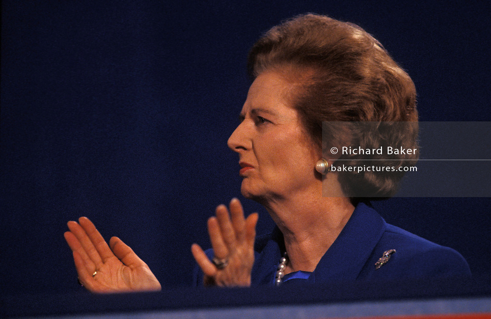Ex-British Prime Minister Margaret Thatcher applauds a speech during the 1991 Tory party conference, on 11th October 1991, in Blackpool, England. Two years after her colleagues deposed her, forcing her to resign from her 11 year premiership she is still in favour by Conservatives who are proud to display her in public, before eventually shunning her policies and profile for their campaigns. Thatcher has been lending her support to her replacement, the former Chancellor and Foreign Secretary, but the otherwise unknown John Major who governed until 1997.