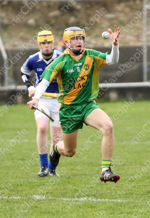 8/3/14  O Callaghans Mills Ciaran Cooney keeps a keen eye on the sliotar against Parteen when the two sides met in Ogonnelloe at the weekend. Pic Tony Grehan / Press 22