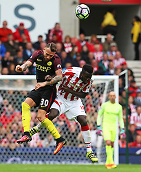 Nicolas Otamendi of Manchester City challenges Mame Biram Diouf of Stoke City  - Mandatory by-line: Matt McNulty/JMP - 20/08/2016 - FOOTBALL - Bet365 Stadium - Stoke-on-Trent, England - Stoke City v Manchester City - Premier League
