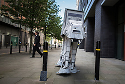 © Licensed to London News Pictures . 25/07/2015 . Manchester , UK . AT-AT on the streets . Visitors to Comic Con on the streets of Manchester after venue - Manchester Central's - doors are shut . Photo credit : Joel Goodman/LNP