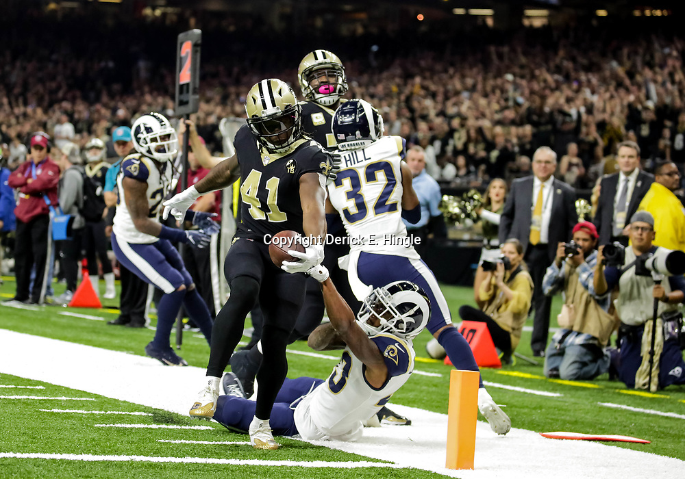 Nov 4, 2018; New Orleans, LA, USA; New Orleans Saints running back Alvin Kamara (41) breaks a tackle by Los Angeles Rams strong safety John Johnson (43) on a touchdown run during the first quarter at the Mercedes-Benz Superdome. Mandatory Credit: Derick E. Hingle-USA TODAY Sports