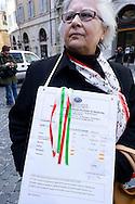 Roma 9 Aprile 2013.Manifestazione dei cittadini di Taranto che protestano contro l'inquinamento e la riapertura di ILVA di fronte alla Camera dei Deputati e in attesa della decisione della Corte costituzionale sulla legge salva-Ilva. Una manifestante mostra le analisi del sangue con i valori alterari dall'inquinamento