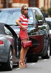 Tara Palmer-Tomkinson wearing a red & white stripy top, red shorts, wedge shoes and matching Chanel quilted handbag, out and about in London. The IT looked as though she got a bit messy with the fake tan, with streaky legs and a stain clearly visible on the back of her top.... UK. 12/08/2013<br />