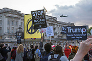 UNITED KINGDOM, London: 03 June 2019<br /> Anti-Trump protesters demonstrate as Marine One - President Trump's helicopter - arrives at Buckingham Palace this evening for his official state banquet with HRH The Queen and other royal and special guests.