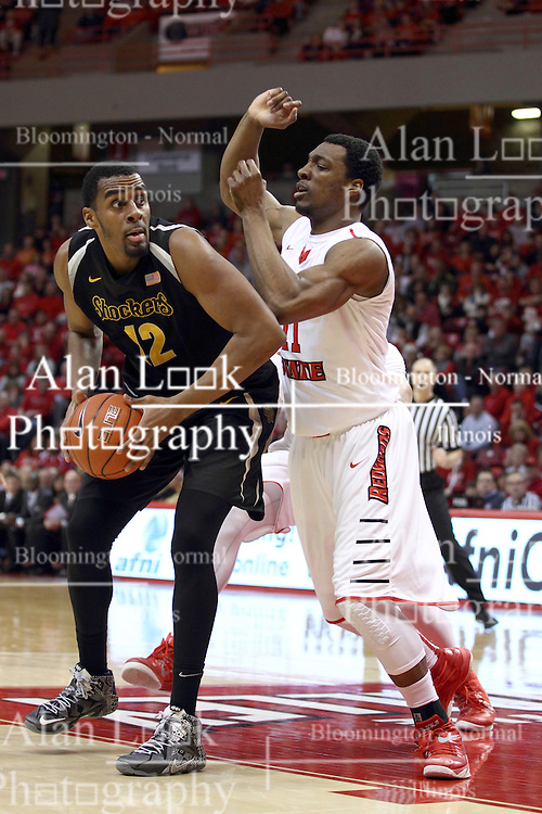 14 February 2015:  Darius Carter looks for a chance to take advantage of MiKyle McIntosh  during an NCAA MVC (Missouri Valley Conference) men's basketball game between the Wichita State Shockers and the Illinois State Redbirds at Redbird Arena in Normal Illinois