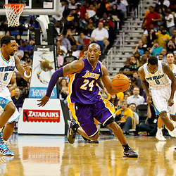Dec 5, 2012; New Orleans, LA, USA; Los Angeles Lakers shooting guard Kobe Bryant (24) drives past New Orleans Hornets shooting guard Roger Mason Jr. (8) during the fourth quarter of a game at the New Orleans Arena. The Lakers defeated the Hornets 103-87.  Mandatory Credit: Derick E. Hingle-USA TODAY Sports