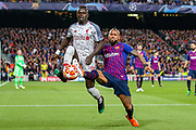 Barcelona defender Arturo Vidal (22) tussles with Liverpool striker Sadio Mane (10) during the Champions League semi-final leg 1 of 2 match between Barcelona and Liverpool at Camp Nou, Barcelona, Spain on 1 May 2019.
