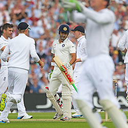 Englands players celebrate the first Indian wicket of India's Gautam Gambhir bowled by England's James Anderson caught behind by wicketkeeper England's Joss Butler during the first day of the Investec 5th Test match between England and India at the Kia Oval, London, 15th August 2014 © Phil Duncan | SportPix.org.uk