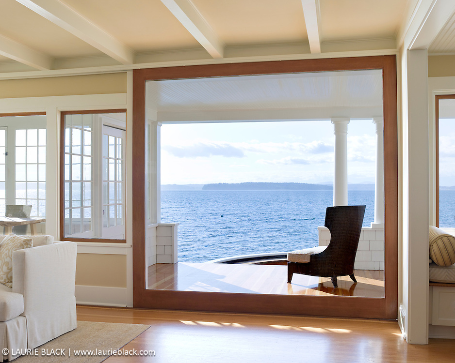 Water view from classic architecture living room and porch