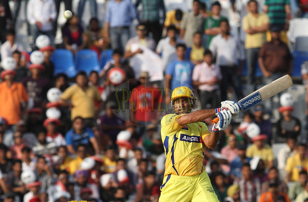 Captain MS Dhoni of the Chennai Super Kings cuts a delivery over the top during match 9 of the Indian Premier League ( IPL ) Season 4 between the Kings XI Punjab and the Chennai Super Kings held at the PCA stadium in Mohali, Chandigarh, India on the 13th April 2011..Photo by Shaun Roy/BCCI/SPORTZPICS