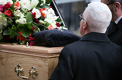 © Licensed to London News Pictures . 18/03/2016 . Manchester , UK . Tony Warren's MBE medal lying on the coffin as it leaves the church. Television stars and members of the public attend the funeral of Coronation Street creator Tony Warren at Manchester Cathedral . Photo credit : Joel Goodman/LNP