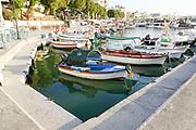Fishing boats in the Venetian era harbour, Chania, Crete, Greece