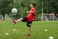 "Caleb ""Rocky"" Allen works on his one touch drills during On Goal Soccer Camp at Leavitt Park Thursday morning. (Karen Bobotas/for the Laconia Daily Sun)"