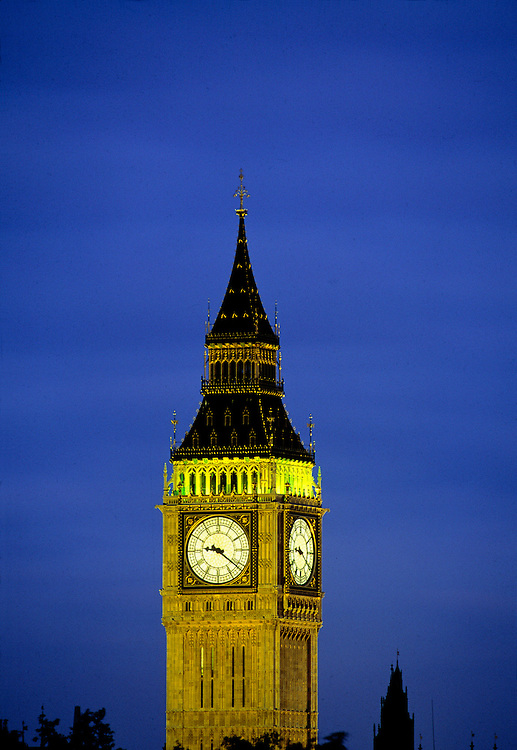 The clock tower with the bell called Big Ben is a familiar landmark in London, England.