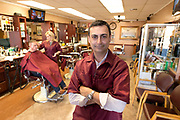 Roman Nektalov is a Russian immigrant owner of Central Barbershop in Downtown Phoenix, AZ. on March 1, 2017.