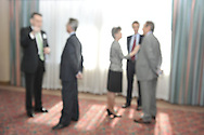 Abstract- people at a business reception
