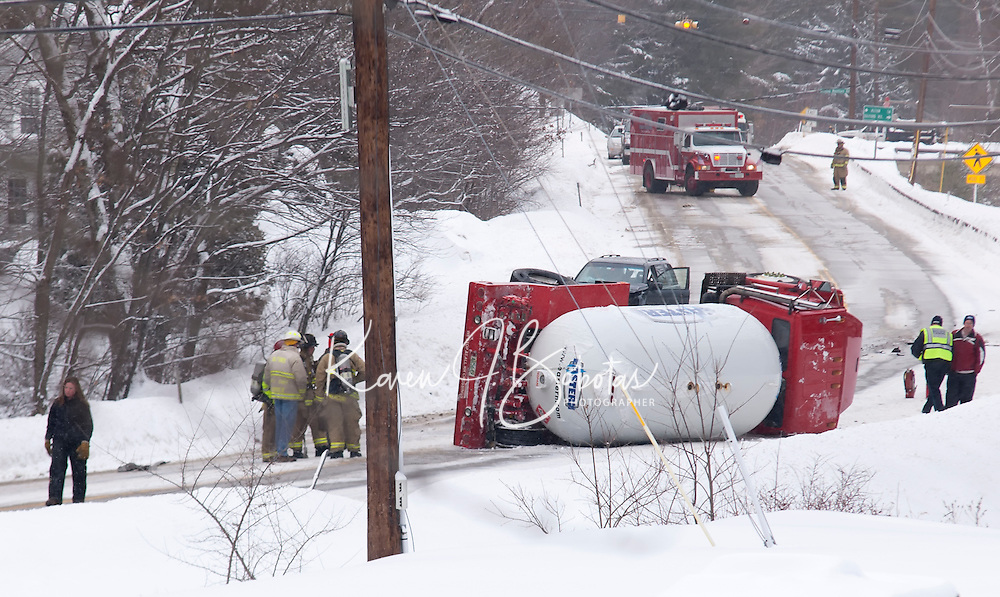 Gilford Fire responds to a two vehicle accident on Route 11A in Gilford Sunday afternoon that resulted in the rollover of an Eastern Propane truck.  (Karen Bobotas/for the Laconia Daily Sun)