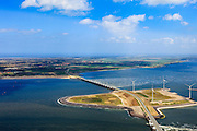 Nederland, Zeeland, Oosterschelde, 09-05-2013; Oosterschelde Stormvloedkering tussen Schouwen en Noord-Beveland met inkomend tij. Sluitgat Hammen met werkeiland Roggenplaat. Links van de kering de de Noordzee, Schouwen-Duiveland in de achtergrond..Storm surge barrier in Oosterschelde (East Scheldt), between Islands of Schouwen-Duiveland and Noord-Beveland; North Sea on the right side of the barrier. Under normal circumstances the barrier is open to allow for the tide to enter and exit. In case of high tides in combination with storm, the slides are closed..luchtfoto (toeslag op standard tarieven).aerial photo (additional fee required).copyright foto/photo Siebe Swart