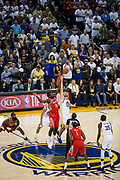 Golden State Warriors center Zaza Pachulia (27) battles Houston Rockets center Clint Capela (15) for the tip-off at Oracle Arena in Oakland, Calif., on October 17, 2017. (Stan Olszewski/Special to S.F. Examiner)
