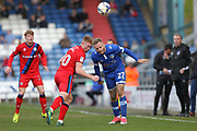 Callum Camps and Ryan McLaughlin go for a header during the EFL Sky Bet League 1 match between Oldham Athletic and Rochdale at Boundary Park, Oldham, England on 22 April 2017. Photo by Daniel Youngs.