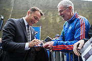 Derby County head coach Darren Wassall signs autographs before the Sky Bet Championship match between Brighton and Hove Albion and Derby County at the American Express Community Stadium, Brighton and Hove, England on 2 May 2016. Photo by Bennett Dean.