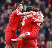 Leyton Orient midfielder Scott Kashket is engulfed by his team mates after scoring a late equaliser during the Sky Bet League 2 match between Leyton Orient and Oxford United at the Matchroom Stadium, London, England on 17 October 2015. Photo by Bennett Dean.