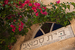 Middle East, Israel, Tel Aviv, Jaff, mosaic tile sign with Hebrew letters and Bouganvilla flowers