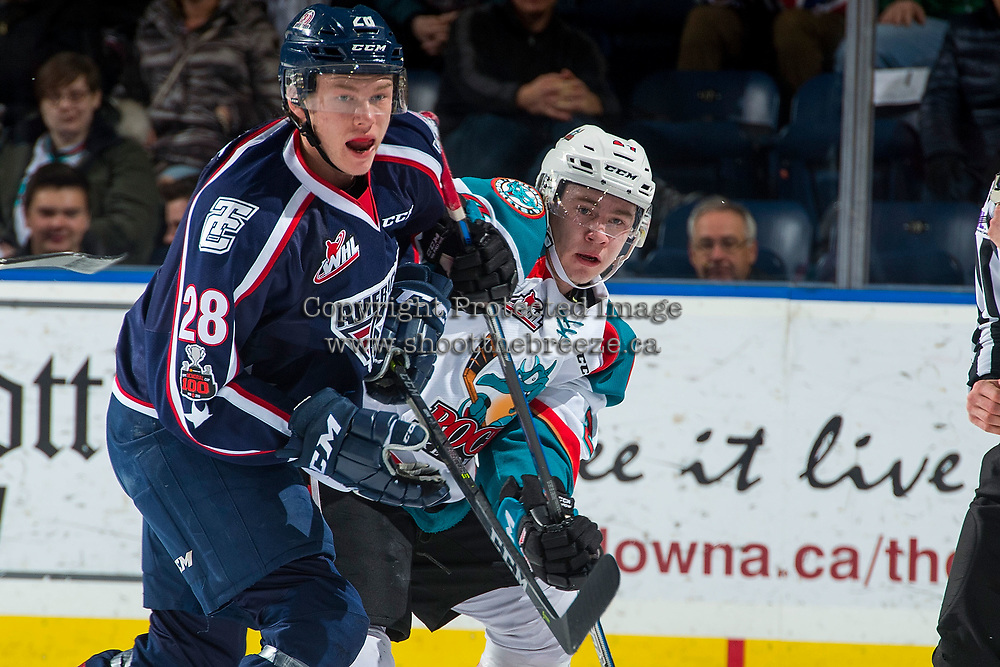 KELOWNA, CANADA - JANUARY 3: Morgan Geekie #28 of the Tri-City Americans checks Kyle Topping #24 of the Kelowna Rockets on January 3, 2017 at Prospera Place in Kelowna, British Columbia, Canada.  (Photo by Marissa Baecker/Shoot the Breeze)  *** Local Caption ***