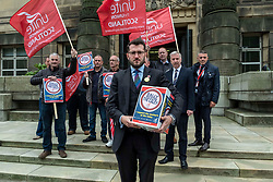 Pictured: Paul Sweeney, Labour and Co-operative MP for Glasgow North East, MSP James Kelly and engineering workers from St Rollox works (Caledonian Works)<br />