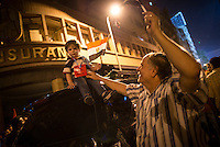 Late in the night near Tahrir Square, protesters, young and old,  continued to fill the streets.