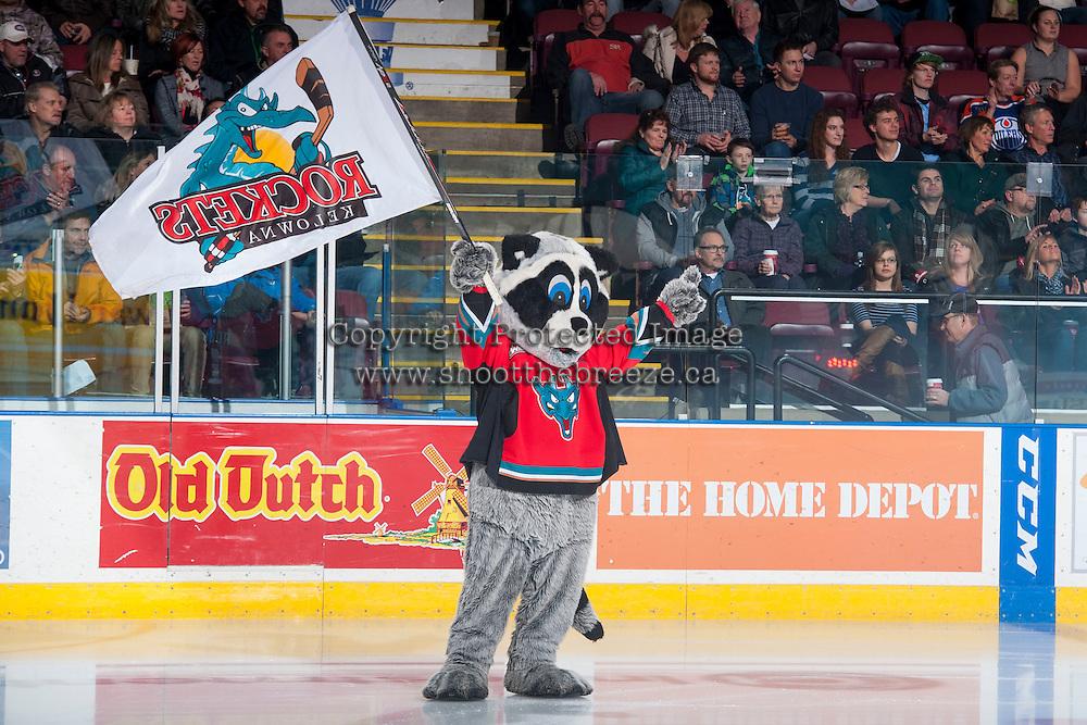 KELOWNA, CANADA - JANUARY 16: Rocky Racoon, the mascot of the Kelowna Rockets waves a flag on the ice against the Seattle Thunderbirdson January 16, 2015 at Prospera Place in Kelowna, British Columbia, Canada.  (Photo by Marissa Baecker/Shoot the Breeze)  *** Local Caption *** Rocky Racoon, mascot;