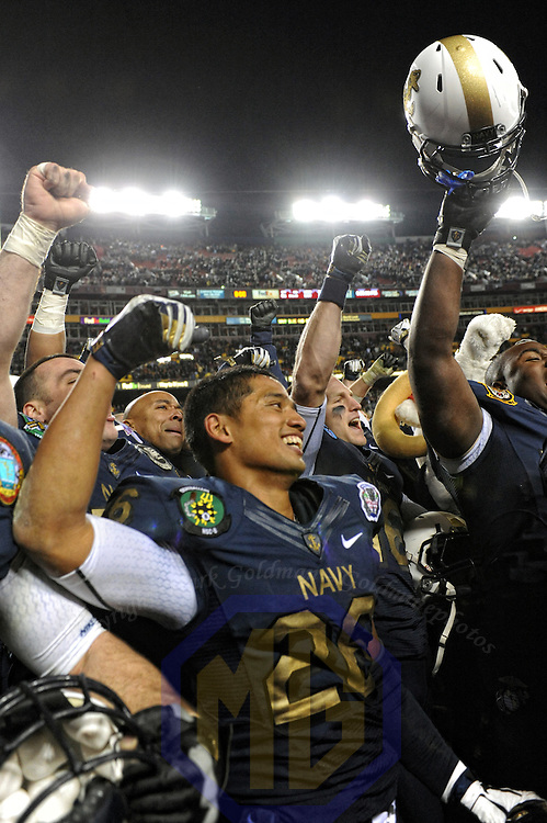 10 December 2011:   Navy Midshipmen running back Aaron Santiago (26) celebrates the win against the Army Black Knights at Fed Ex field in Landover, Md. in the 112th annual Army Navy game where Navy defeated Army, 27-21 for the 10th consecutive time.