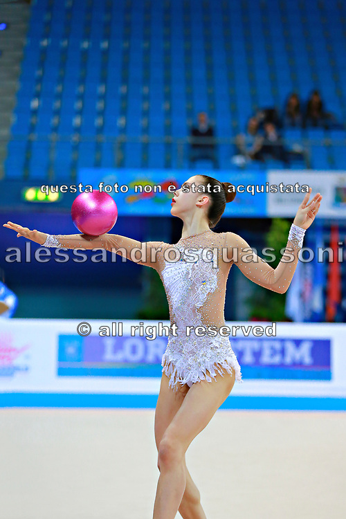 Berezina Polina during qualifying at ball in Pesaro World Cup 10 April 2015.<br /> Polina Berezina is a Spanish individual rhythmic gymnast of Russian origin was born in Moscow in Russia on December 5, 1997, she has been living in Spain near Alicante for some years, her team is Club Torrevieja and she is coached by Mónica Ferrández.