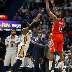 Mar 17, 2018; New Orleans, LA, USA; Houston Rockets guard James Harden (13) shoots over New Orleans Pelicans guard Jrue Holiday (11) during the second half at the Smoothie King Center. The Rockets defeated the Pelicans 107-101. Mandatory Credit: Derick E. Hingle-USA TODAY Sports
