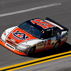 April 17, 2011; Talladega, AL, USA; NASCAR Sprint Cup Series driver Michael Waltrip (15) drives an Auburn University color schemed car during the Aarons 499 at Talladega Superspeedway.   Mandatory Credit: Derick E. Hingle