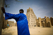 A man stands near Sankoré Mosque, in Timbuktu, Mali.