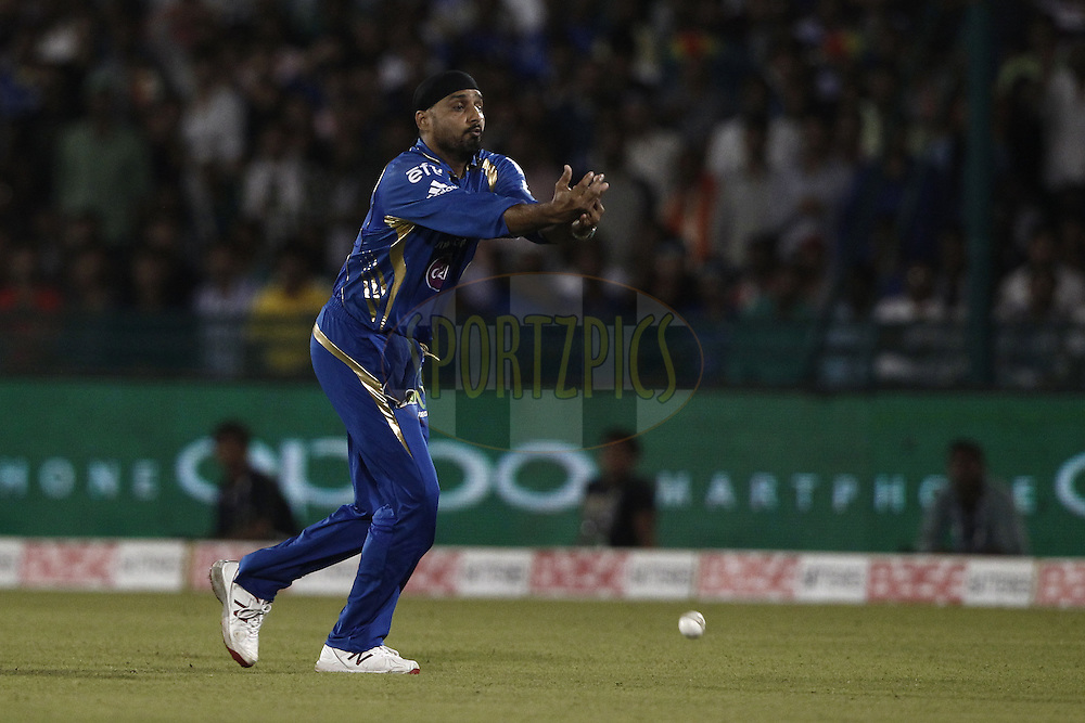 Harbhajan Singh of the Mumbai Indians drop the catch of Danushka Gunatilake of the SOUTHERN EXPRESS during the qualifier 4 match of the Oppo Champions League Twenty20 between the Mumbai Indians and the Southern Express held at the Chhattisgarh International Cricket Stadium, Raipur, India on the 14th September 2014<br /> <br /> Photo by:  Deepak Malik / Sportzpics/ CLT20<br /> <br /> <br /> Image use is subject to the terms and conditions as laid out by the BCCI/ CLT20.  The terms and conditions can be downloaded here:<br /> <br /> http://sportzpics.photoshelter.com/gallery/CLT20-Image-Terms-and-Conditions-2014/G0000IfNJn535VPU/C0000QhhKadWcjYs