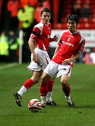 London, England - Saturday, January 12th, 2008:  Charlton Athletic's Zheng Zhi and Matt Holland in action against Blackpool during the League Championship match at The Valley. (Pic by Chris Ratcliffe/Propaganda)