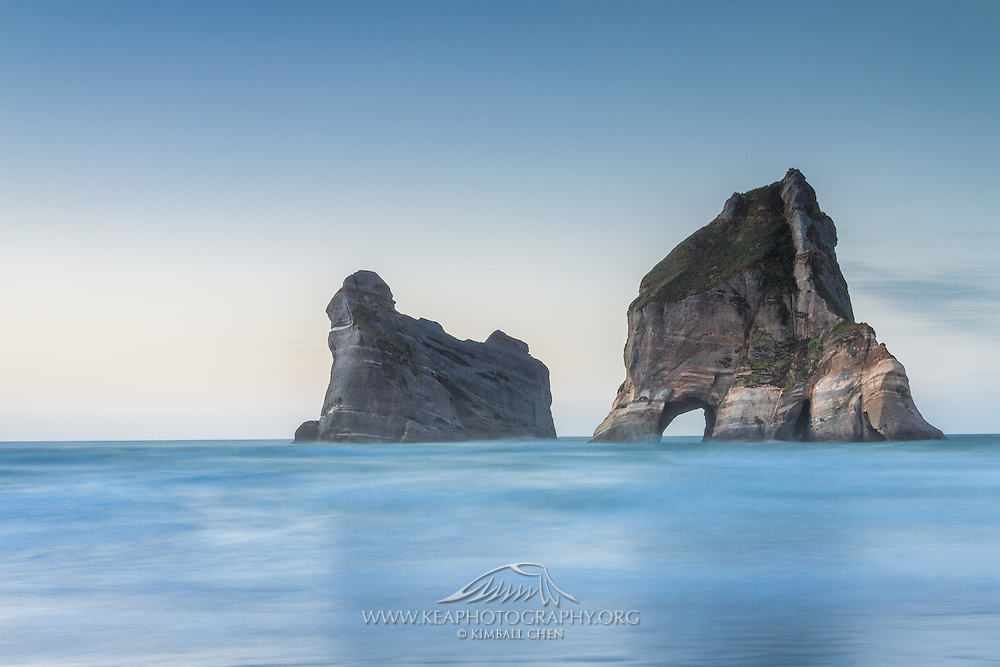 A 13-second exposure of the incoming tide and Archway Islands at Wharariki Beach, New Zealand