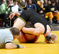 Iowa's Luke Lofthouse works on pinning Southern Illinois Edwardsville's Robert Cooney as referee Bill Roths looks on during the 197-pound bout of their dual at Carver-Hawkeye Arena, 1 Elliot Drive in Iowa City on Friday evening January 7, 2010. Lofthouse pinned Cooney in 3:36 and Iowa defeated Southern Illinois Edwardsville 49-0.