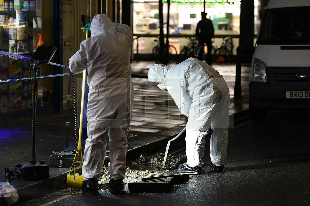 © Licensed to London News Pictures. 07/03/2019. London, UK. Police forensics search a drain at the scene at Lanfrey Place in West Kensington, London where a man in his teens has died after being stabbed multiple times. Police were called at 2.14PM today. Photo credit: Guilhem Baker/LNP