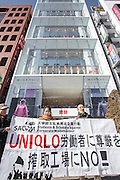Activist, Alexandra Chan from Hong Kong workers' rights NGO, SACOM gives a talk in front of Uniqlo's flagship store in Ginza about abuses of workers in factories in China that supply the Japanese brand Uniqlo Store. Ginza, Tokyo, Japan. Sunday, January 18th 2015