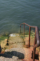 Steps with rusty handrail to the sea, Sandycove, County Dublin, Ireland